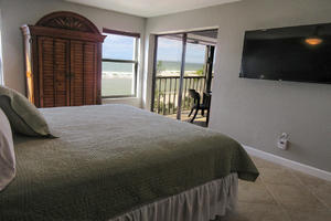 Master Bedroom has Large Screen TV and Private Lanai Access
