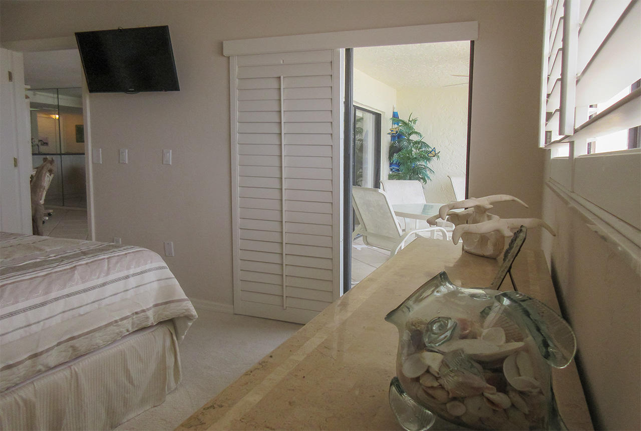 Private Lanai Access and TV in the Master Bedroom