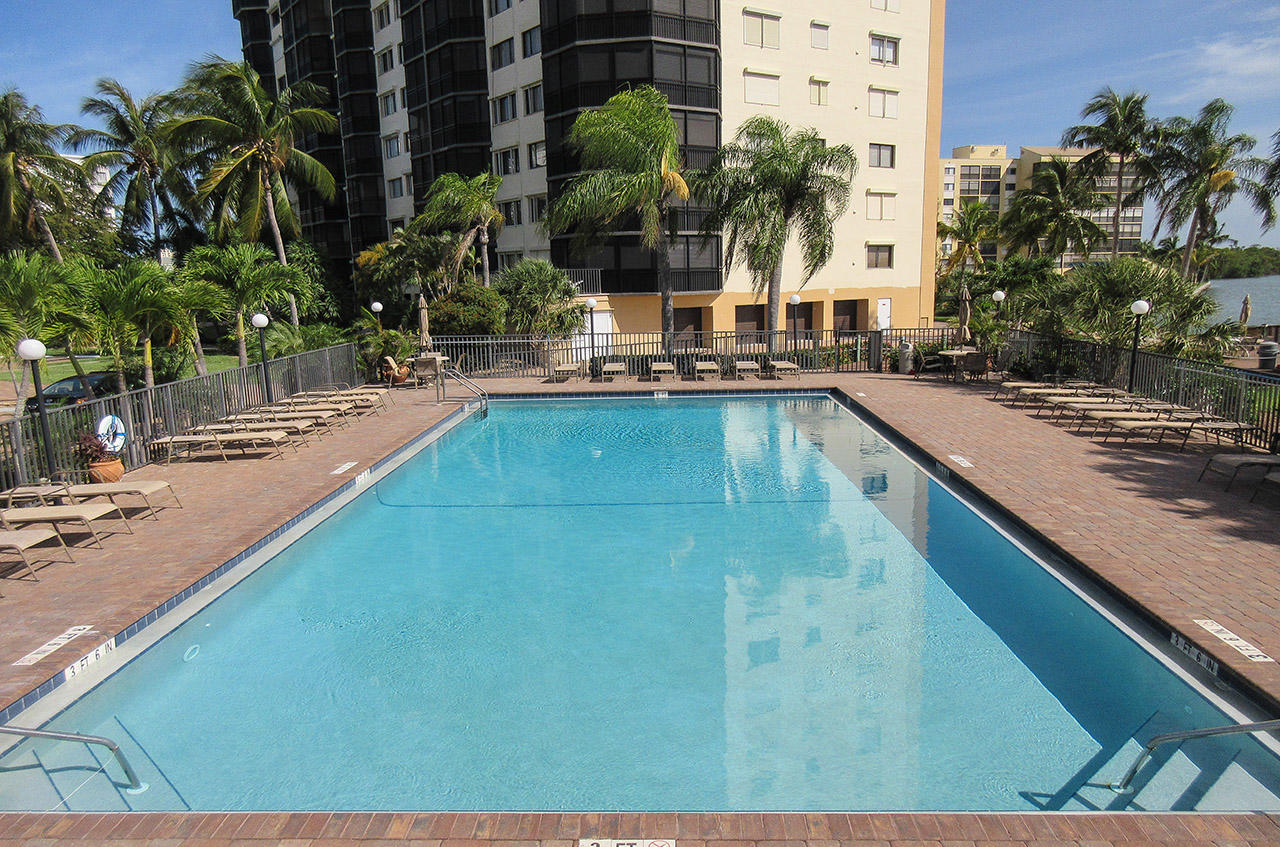 Harbour Pointe Resort Condominiums - Heated Pool Overlooking the Bay with Plenty of Lounge Chairs. Hello Florida Sunshine!