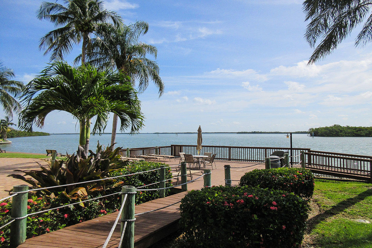 Harbour Pointe Resort Condominiums - Relax in the the Florida sunshine and watch the boats go by