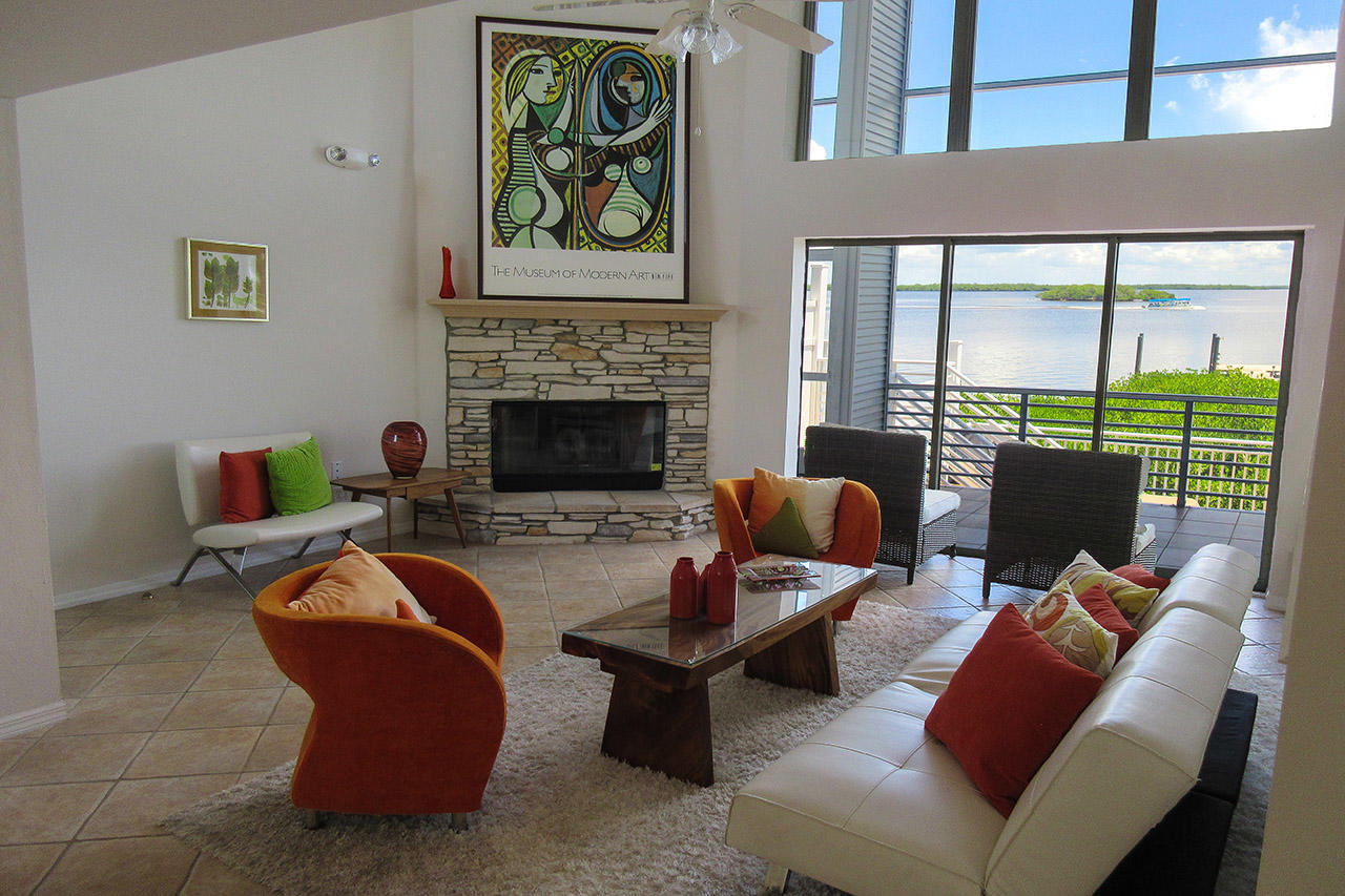 Fantastic Two Story View of the Bay from the Living Room with Fireplace