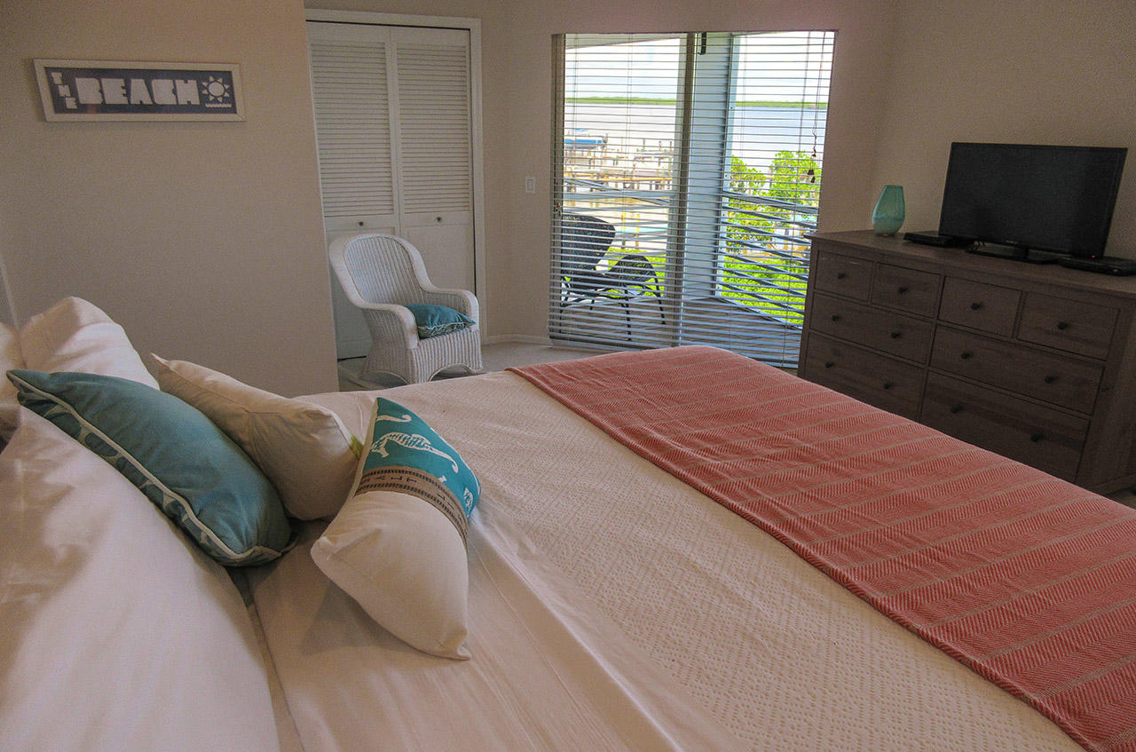 Master Bedroom has TV and private Screened in Lanai