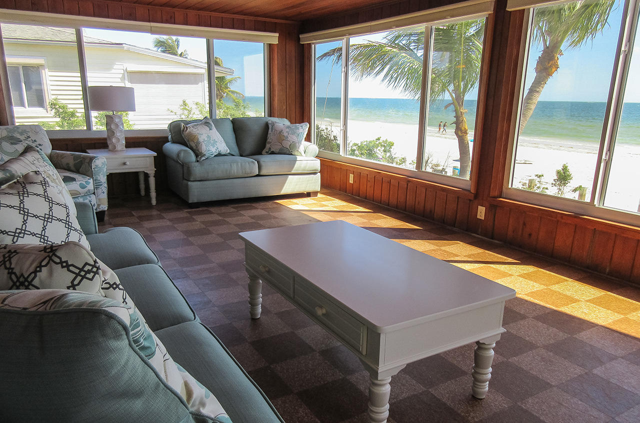 Relax and enjoy the fabulous view from the sunroom with wrap around windows