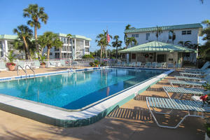 Soak Up the Sun and Take A Dip! Privateer Beachfront Vacation Condos have a resort sized heated pool and sundeck