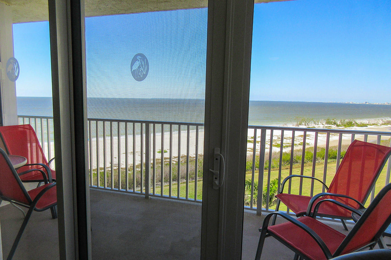 Relax on the balcony overlooking the Gulf at Estero Beach And Tennis Club 607C