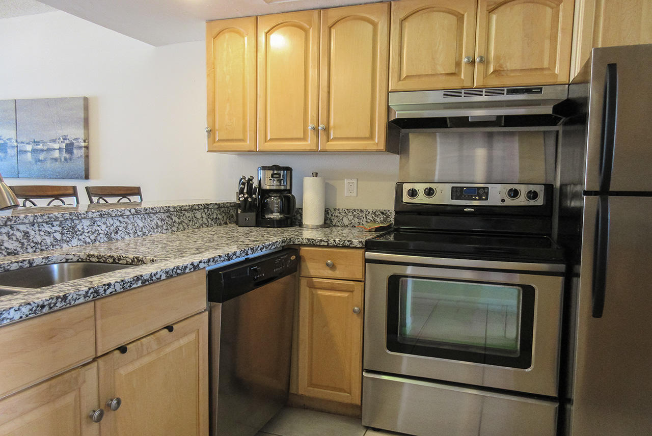Kitchen with dishwasher at Castle Beach 302