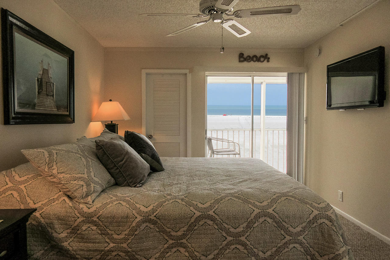 Master Bedroom has its own private lanai access and TV