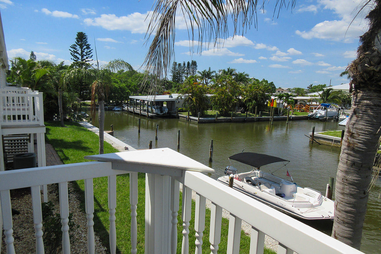 Island Breeze Vacation Rental Condo looks out over a wide canal.