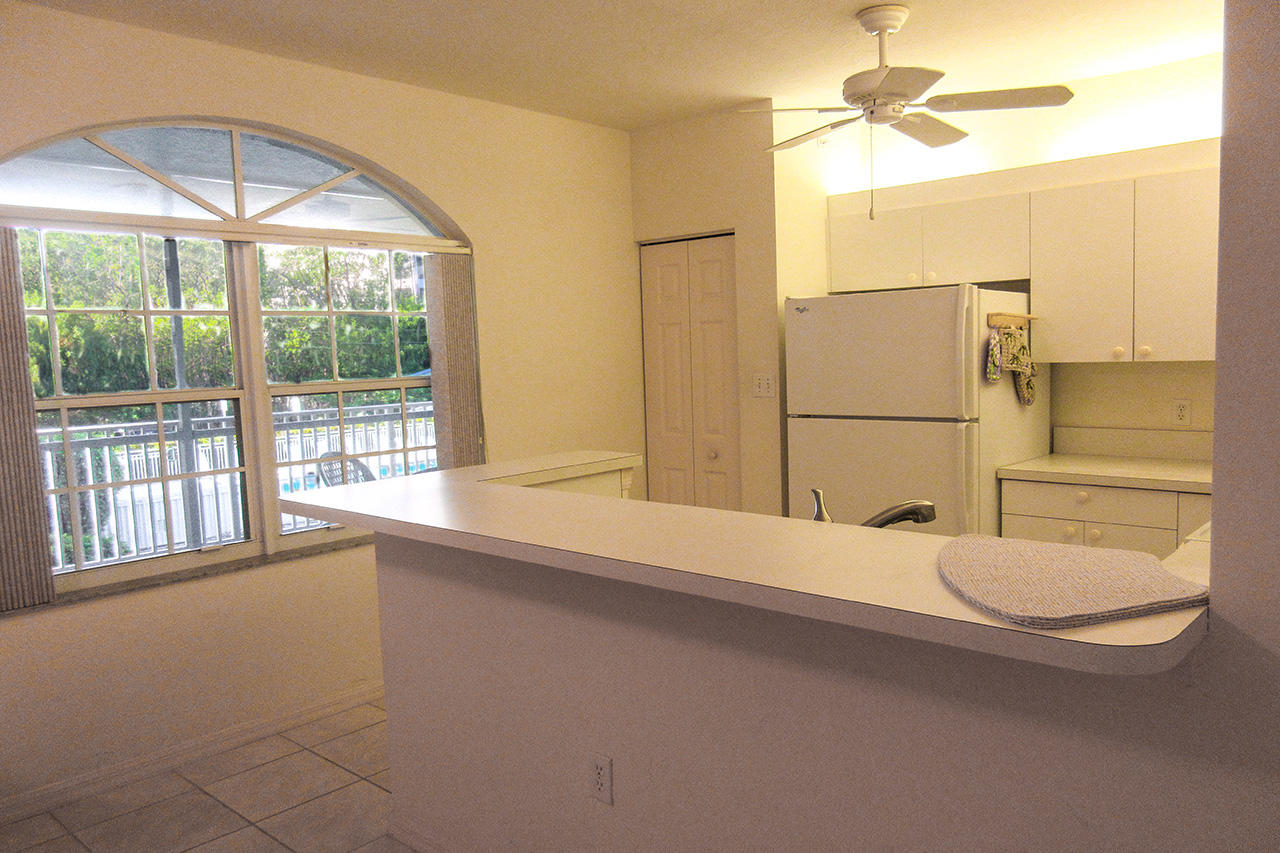 Bright, white, fully-equipped kitchen
