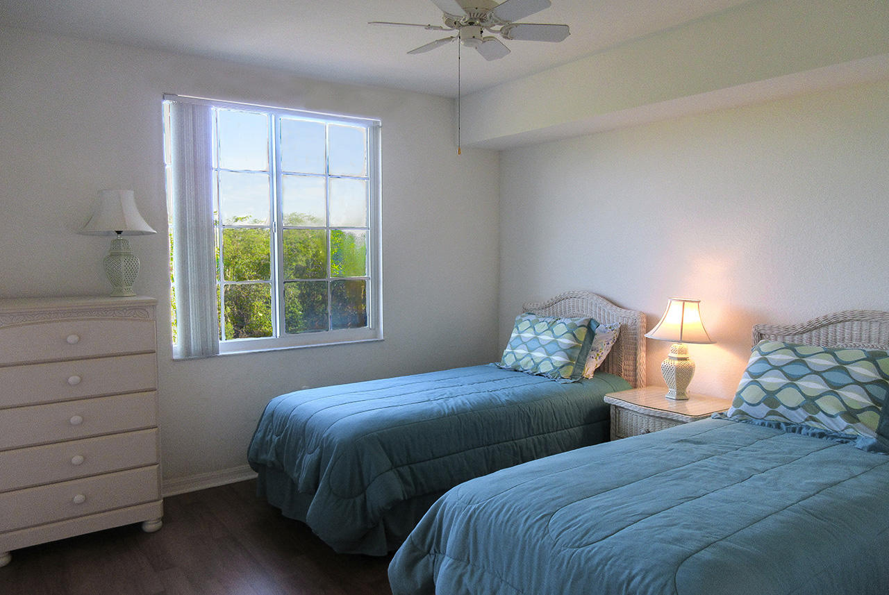Large Guest Bedroom has two twins and private lanai access