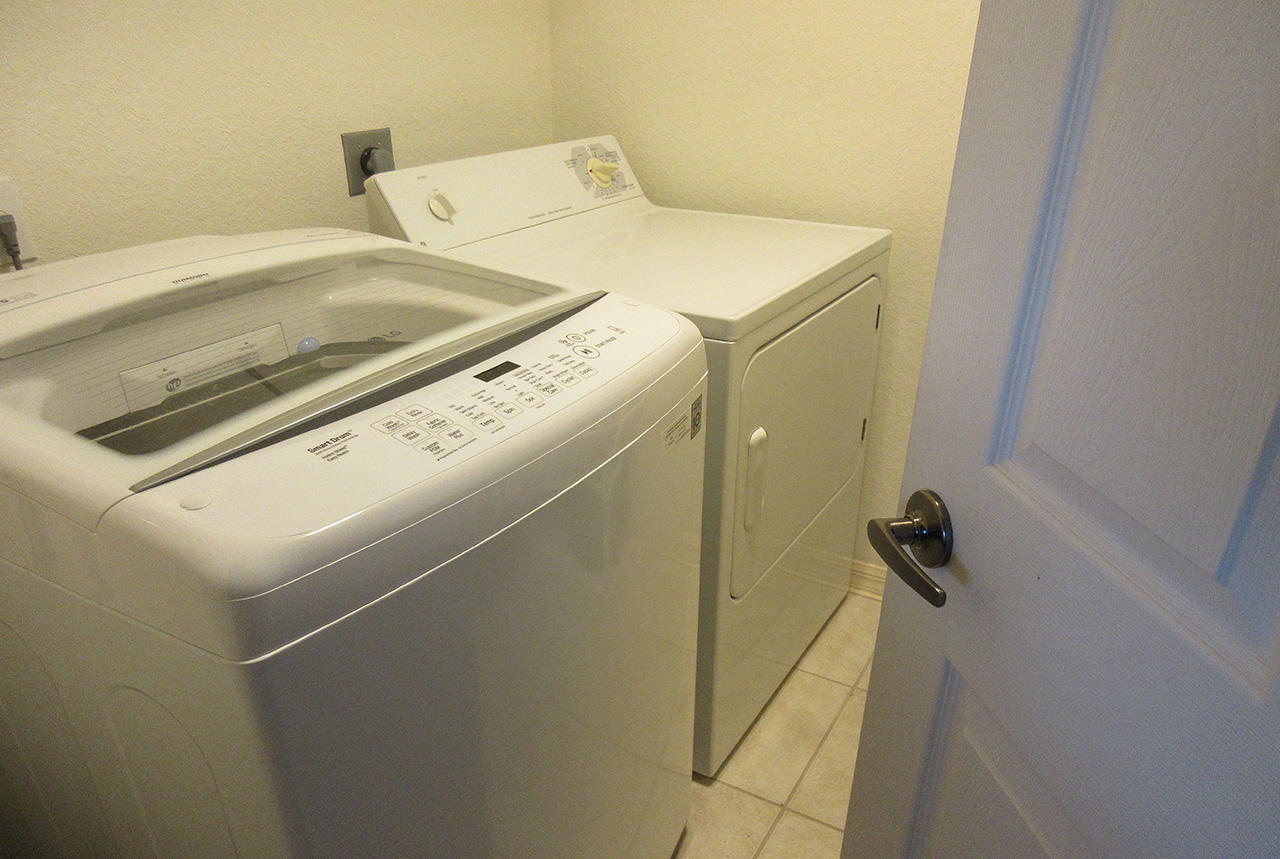 Laundry room off the kitchen has washer and dryer