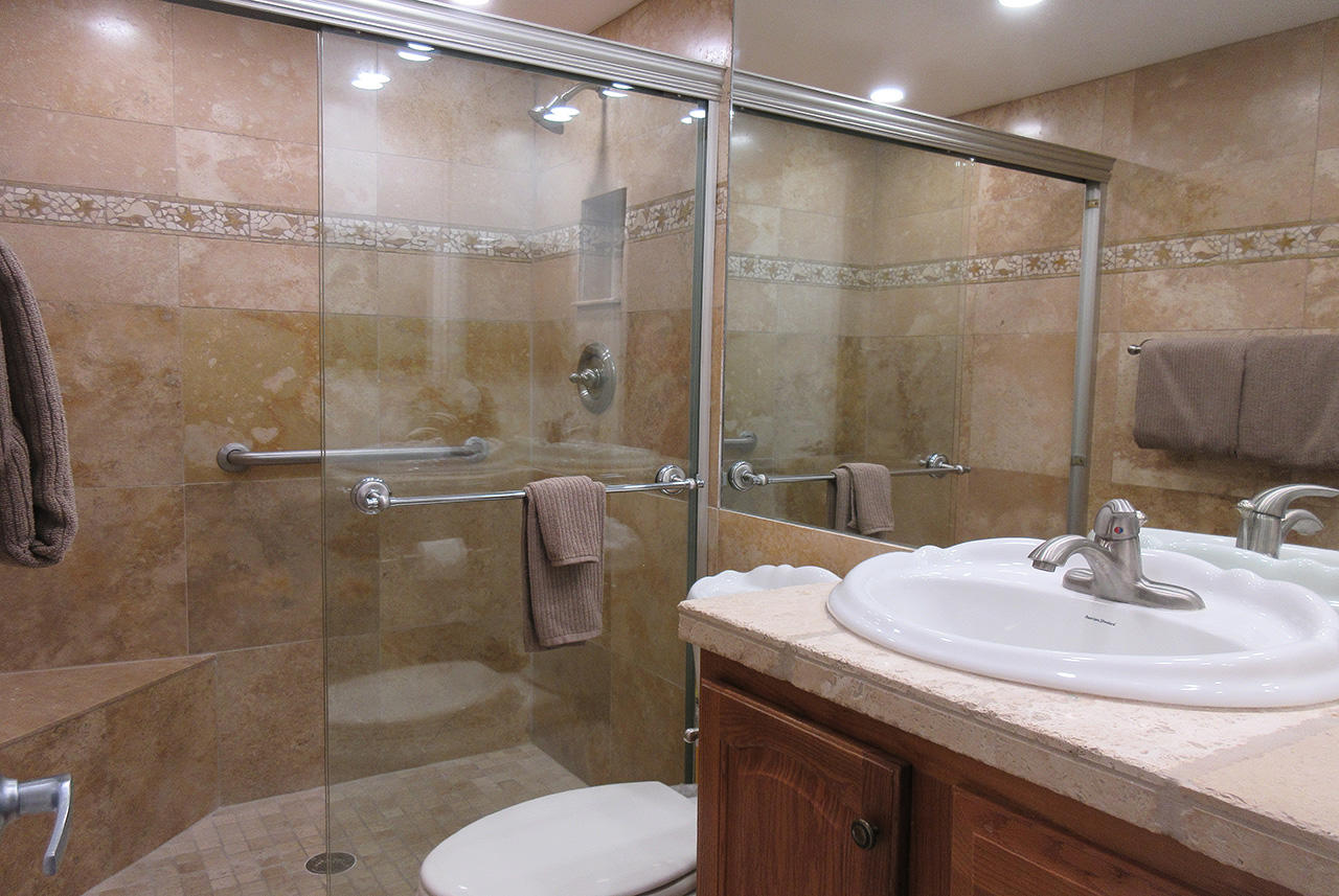 Guest Bath also features a tiled, walk in shower