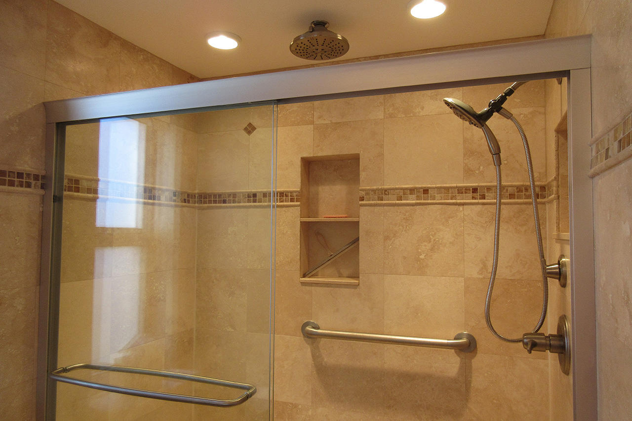 Master Bath has a walk in tiled shower with designer showerheads
