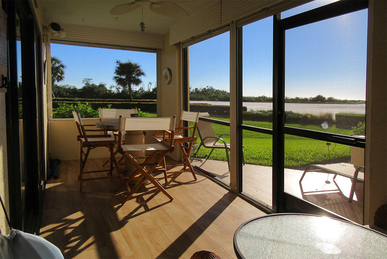 Dine out in large screened in lanai at Sandarac 107A