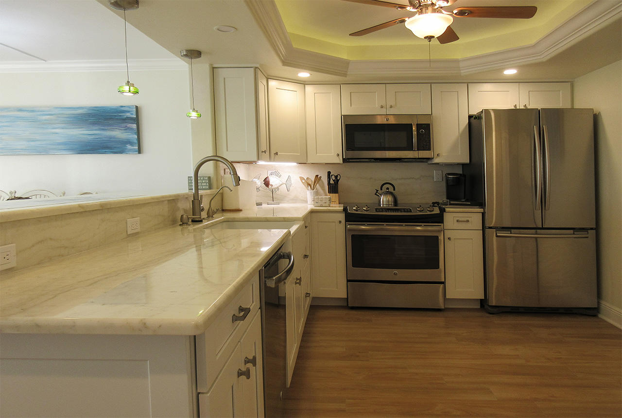 Professionally designed kitchen with marble countertops