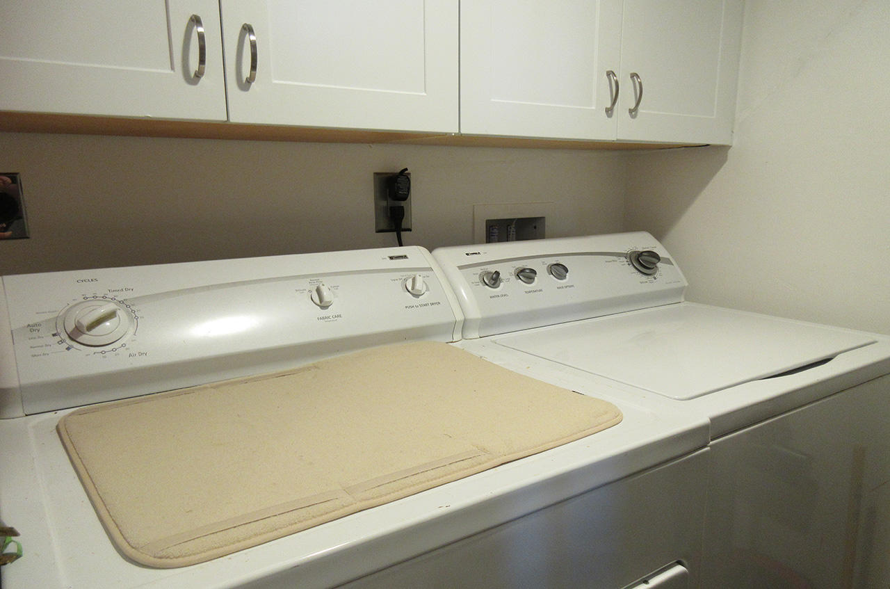 In Unit Laundry room at Sandarac 107A