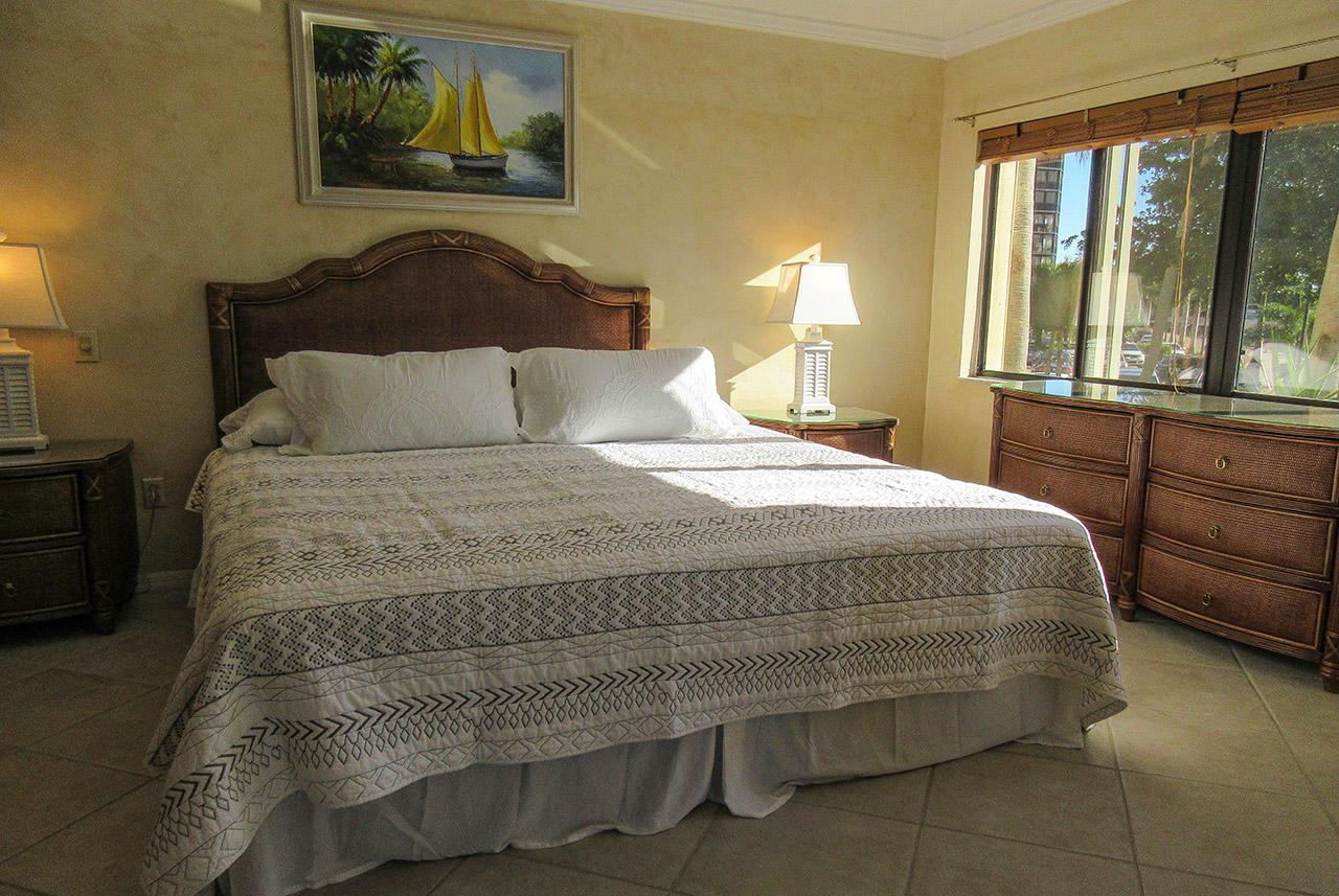 King Sized Bed sits in this inviting Master Bedroom