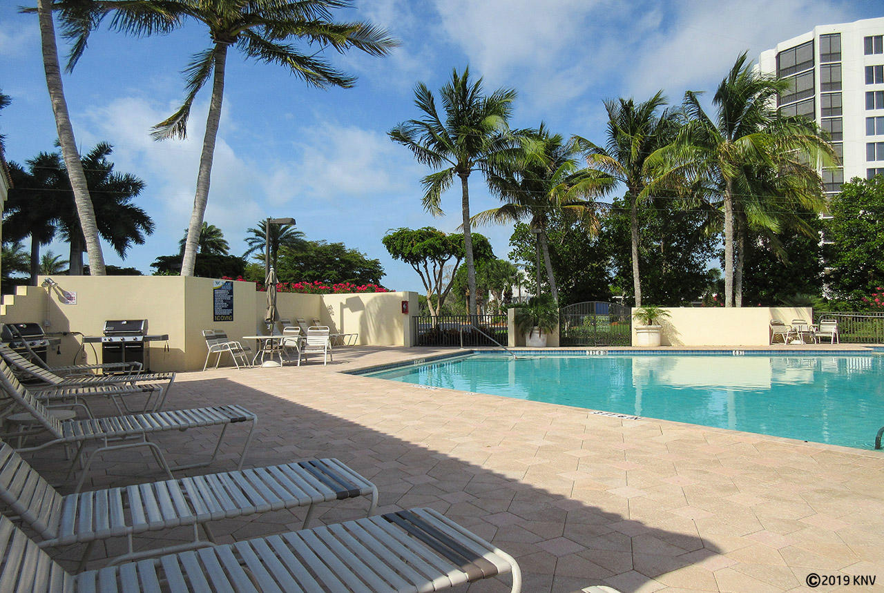 Waterside I features a Resort Sized Heated Pool and Sundeck with Lounge Chairs