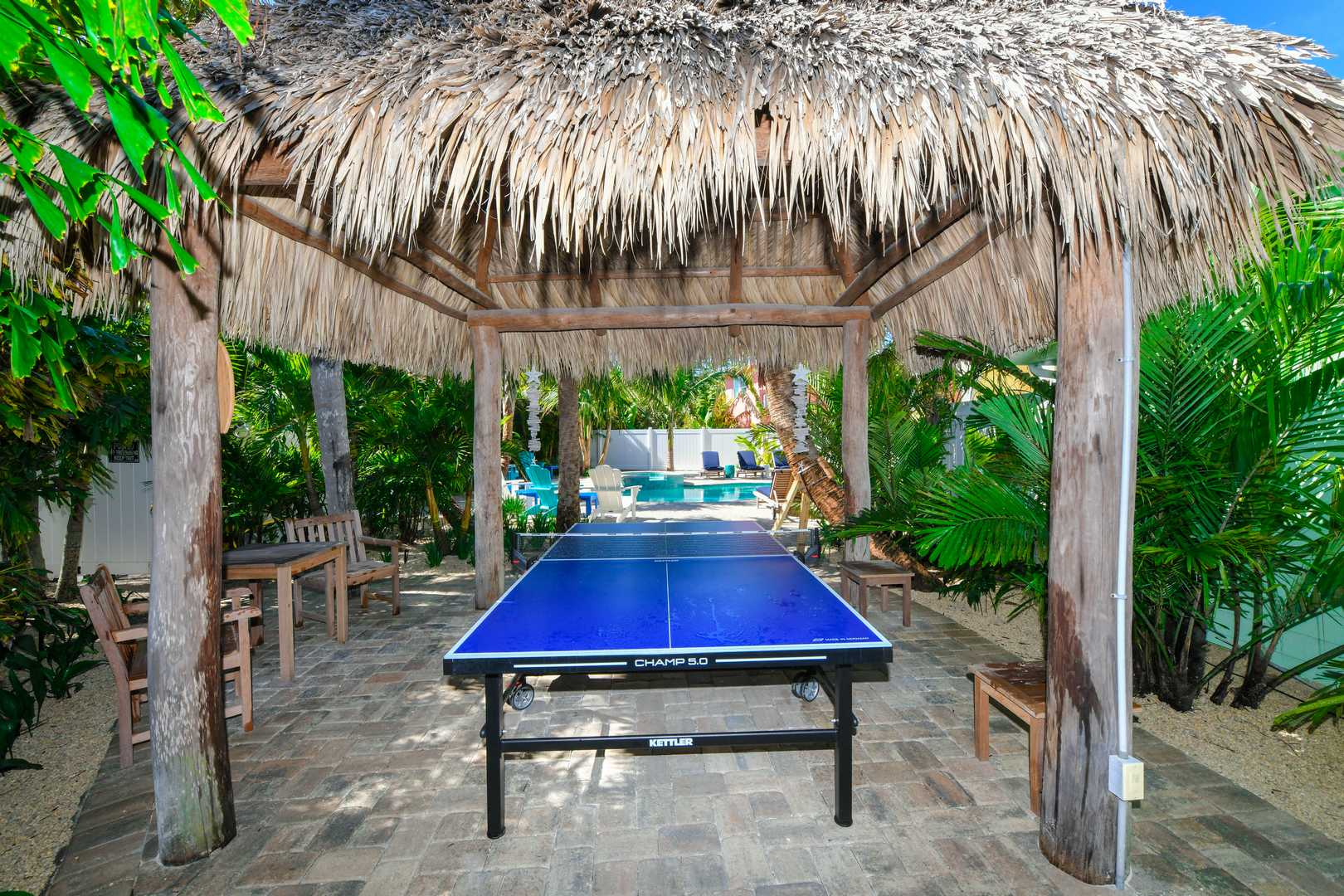 Ping Pong. Tiki Hut. Seating. Ring Game. Located off Pool