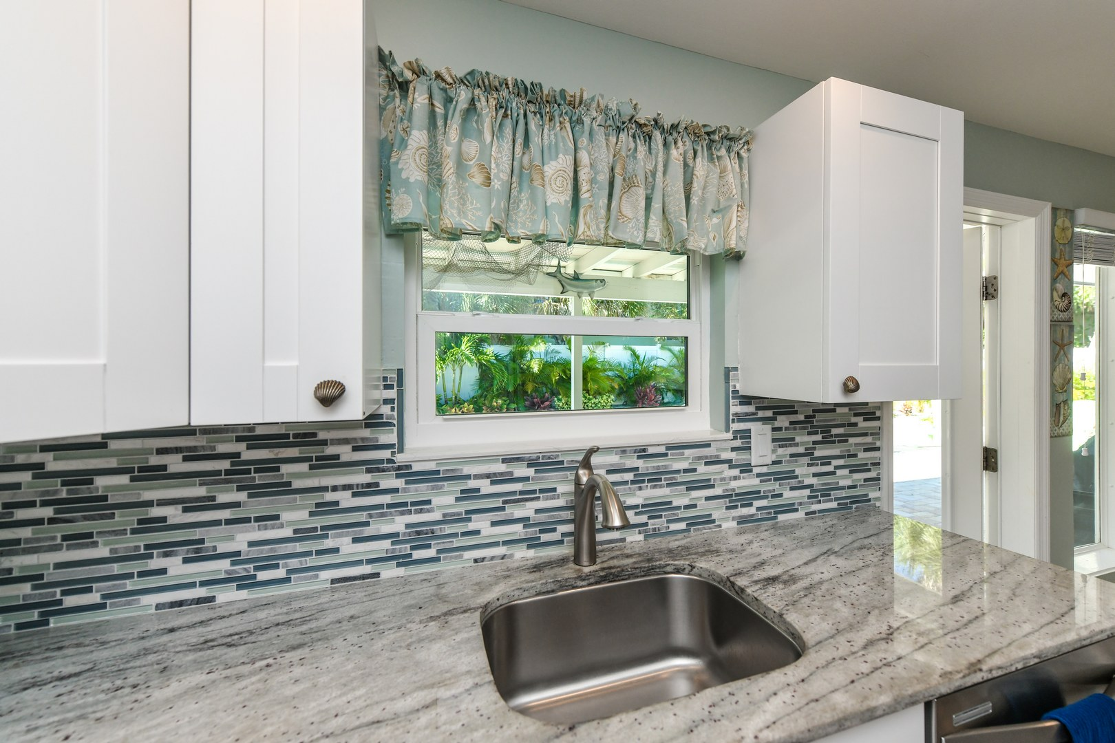 Beautiful Countertops, Wood Cabinetry. Colorful Back Splash