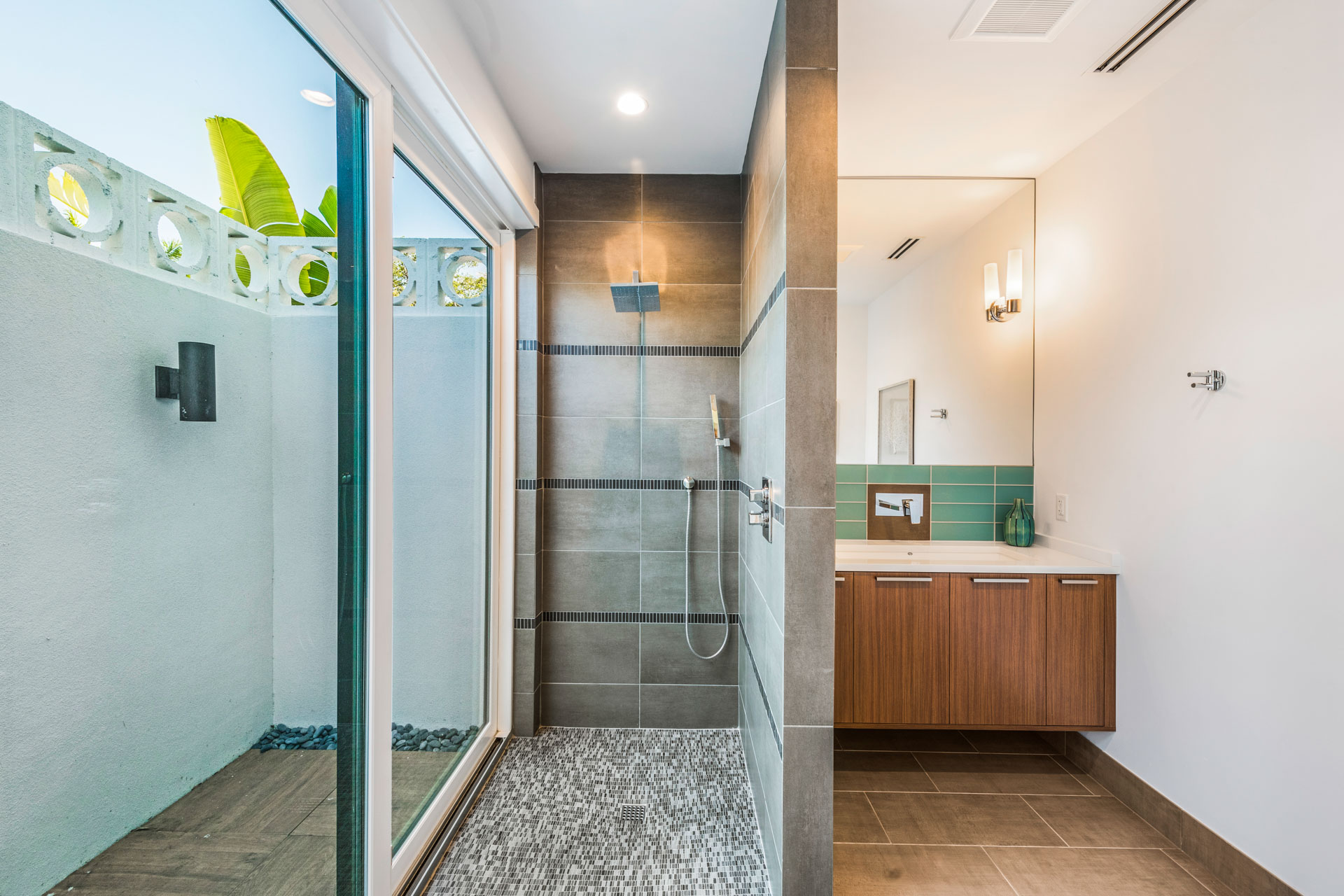 Master Bath With Indoor and Outdoor Walk in Showers