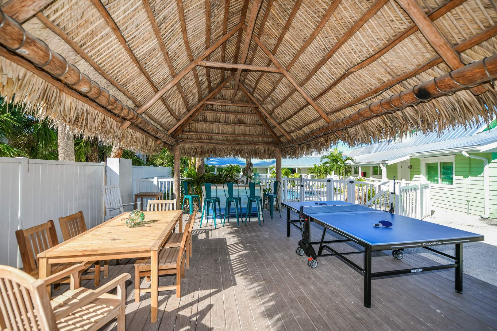 Challenge your frineds to a game of Ping Pong under the tiki