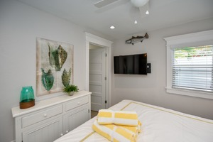 Master bathroom located at the foot of the bed