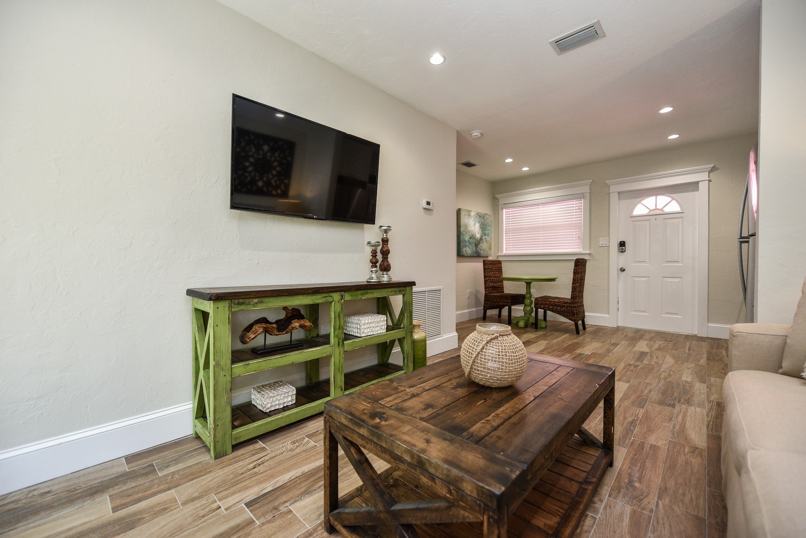 Large HDTV. Spacious Living Area with Great Natural Light