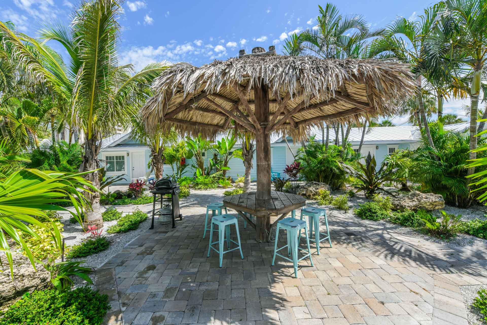Your Courtyard. Tiki Hut. Seating. BBQ Grill.