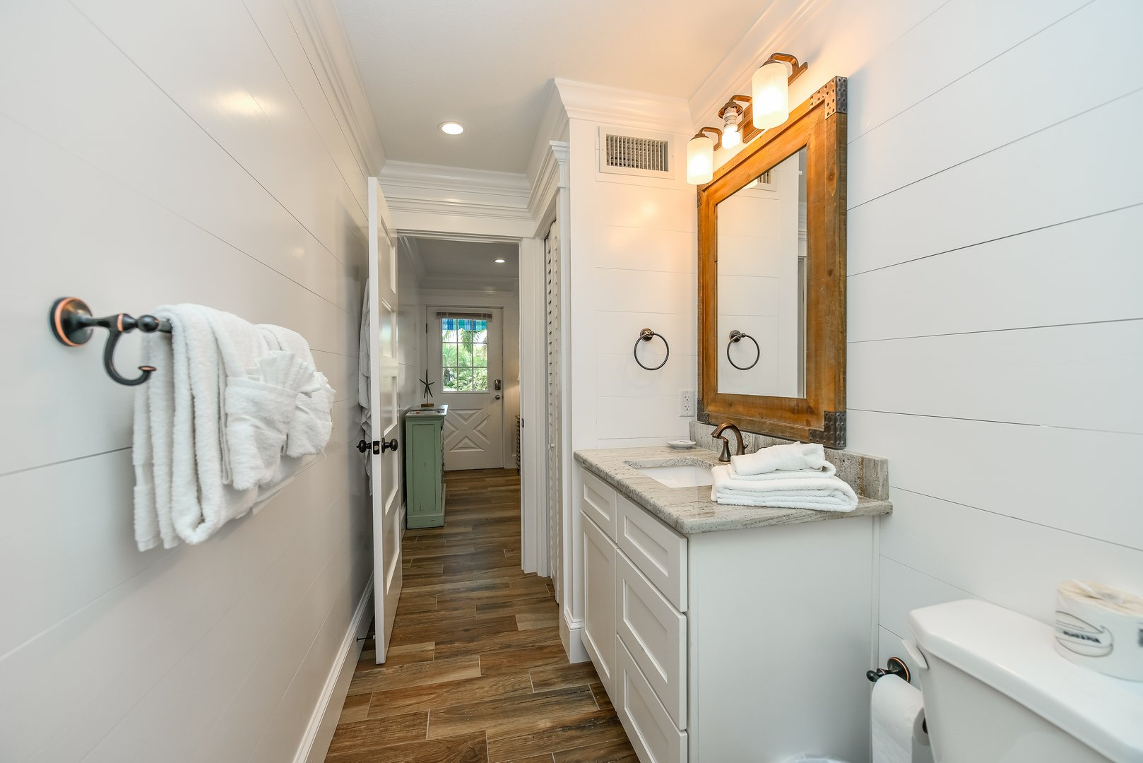 Vanity and bathroom entrance