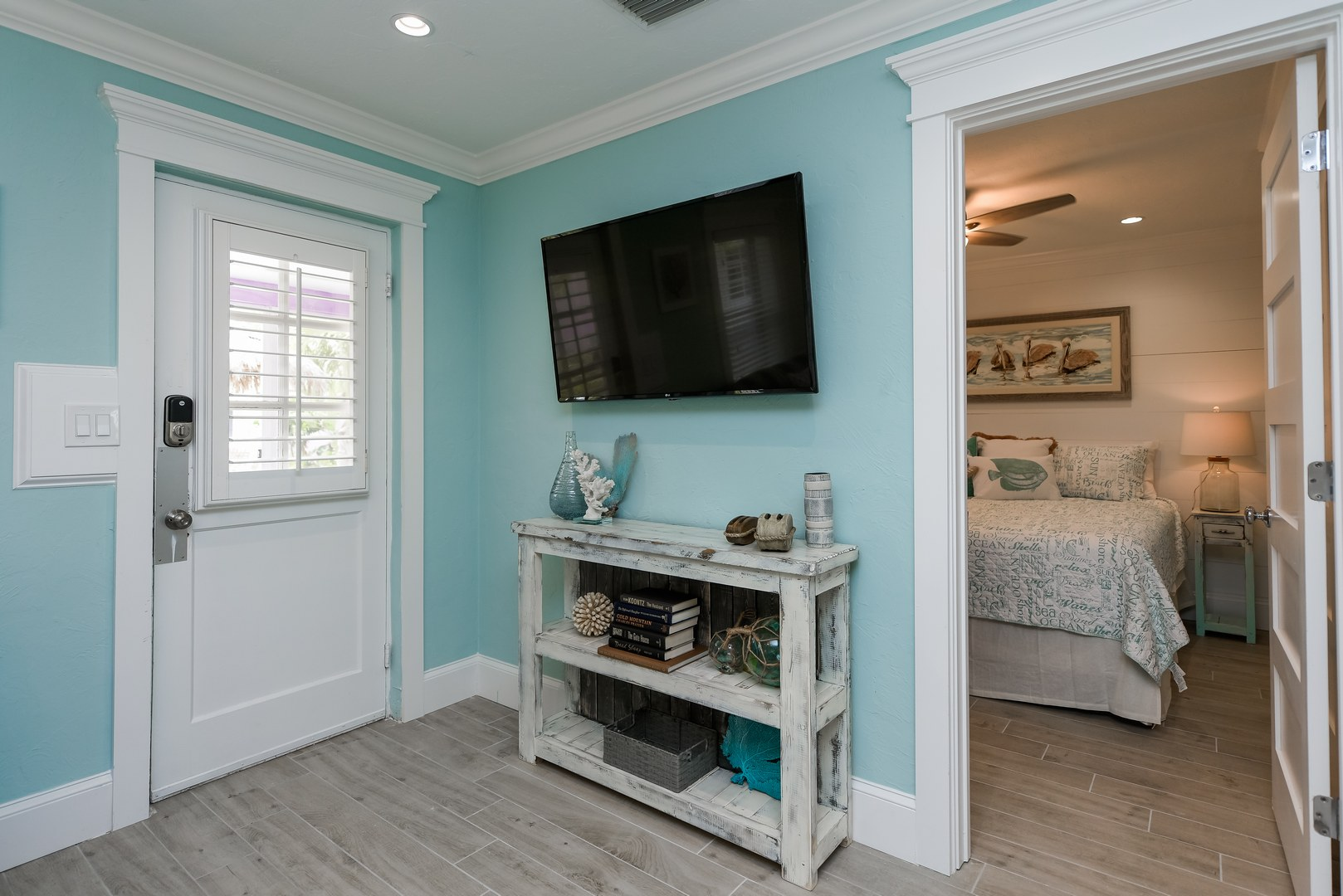 Entrance to the Unit, HDTV in Living Room, Access to Bedroom