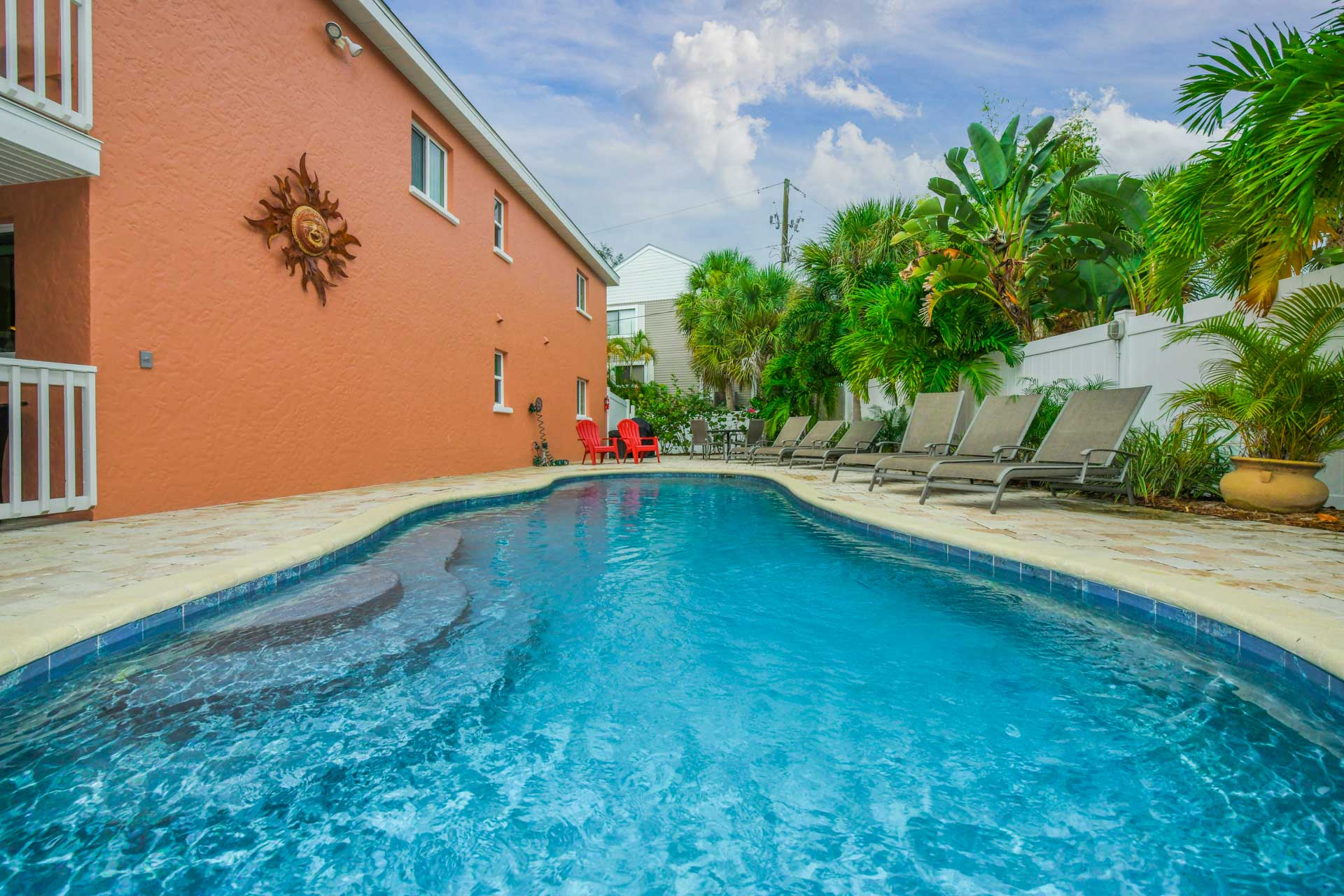 Soak up the sun in the shared heated pool