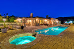 Hot tub and salt water pool with ocean views, fire pit, BBQ, and plenty of outdoor lounging and dining areas.