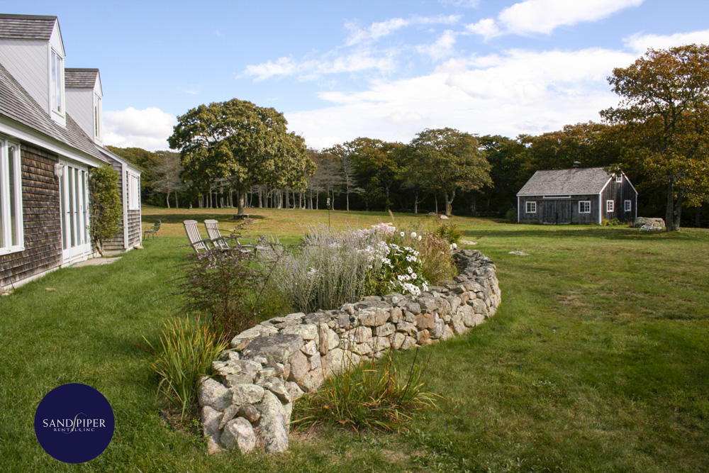 Lovely grounds of property with stone wall