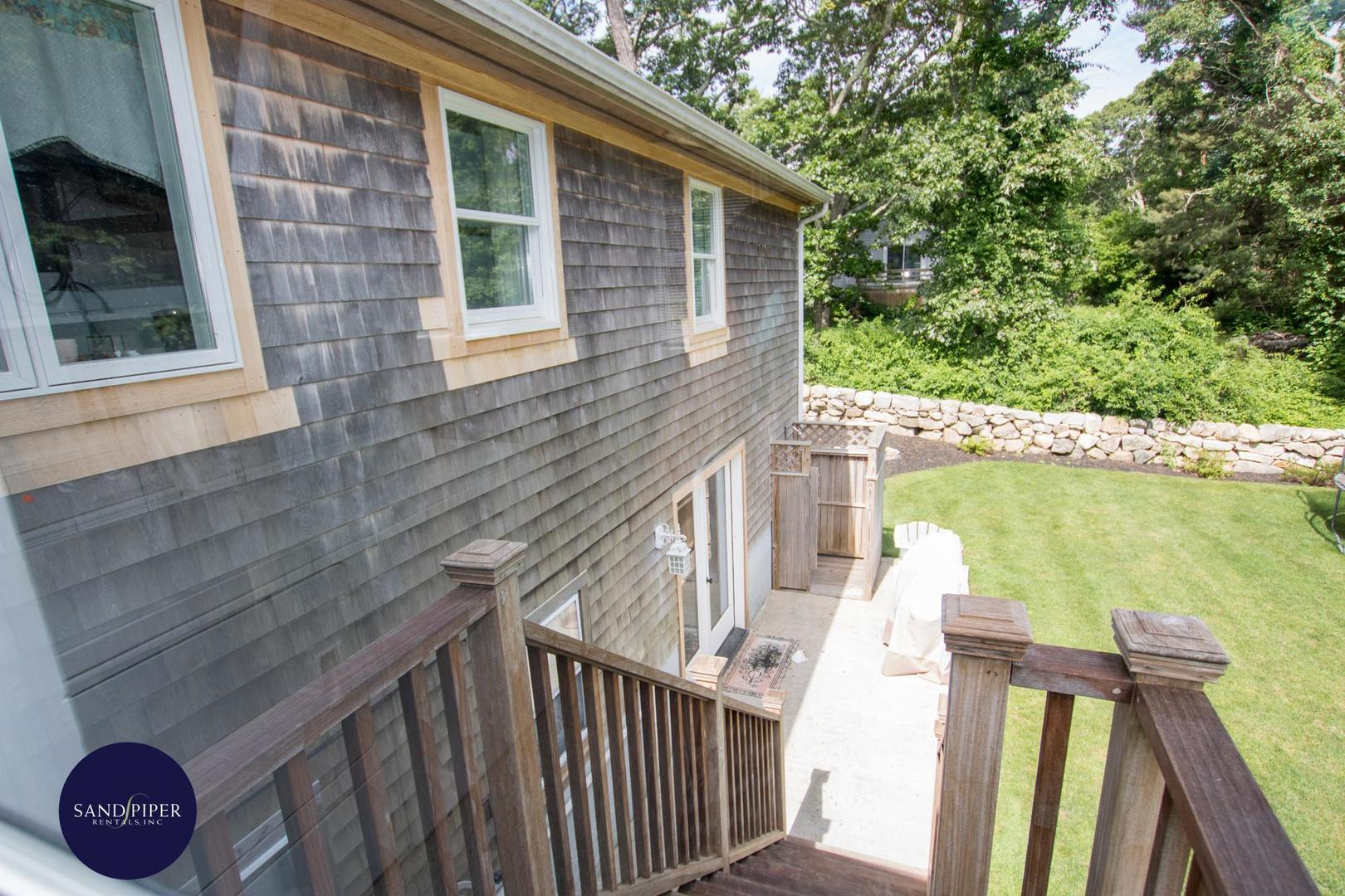 Exit from porch to backyard and enclosed outdoor shower