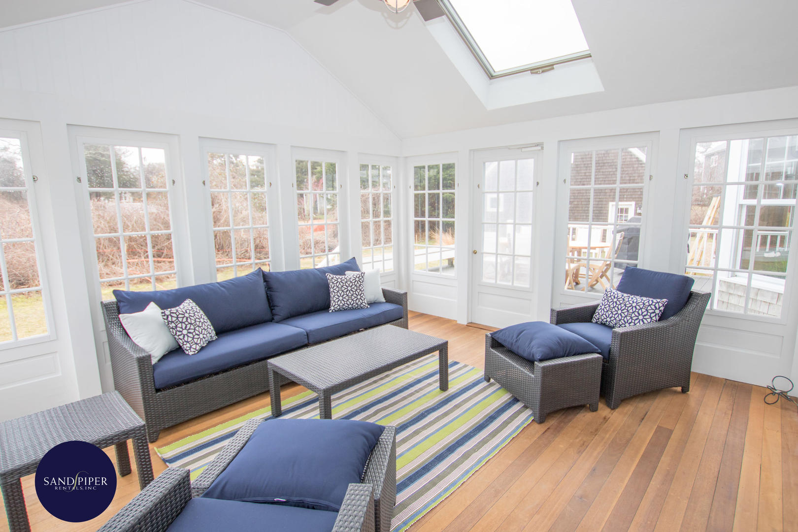 Sun room off family room with pool view