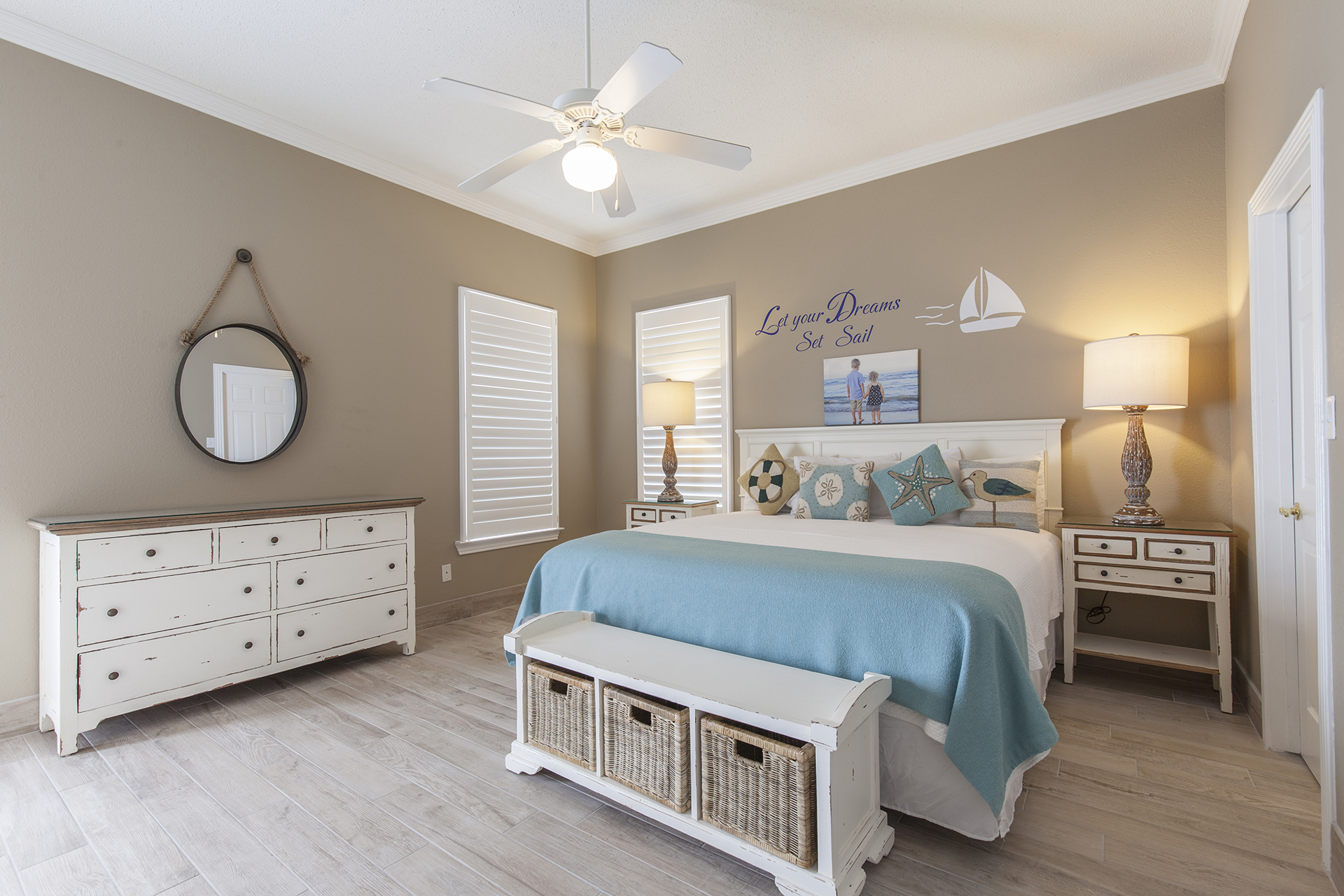 Beautiful master bedroom with cool coastal colors