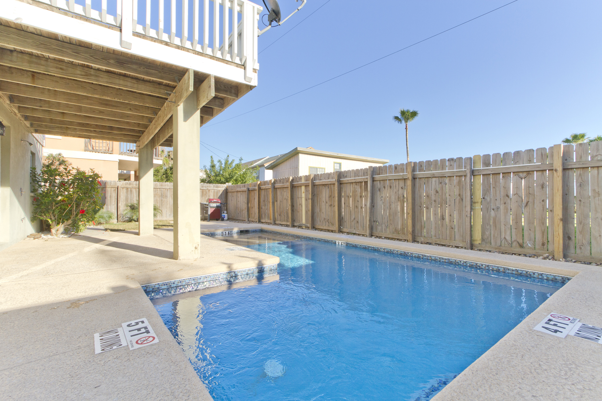 Fenced backyard with private heated pool and BBQ pit