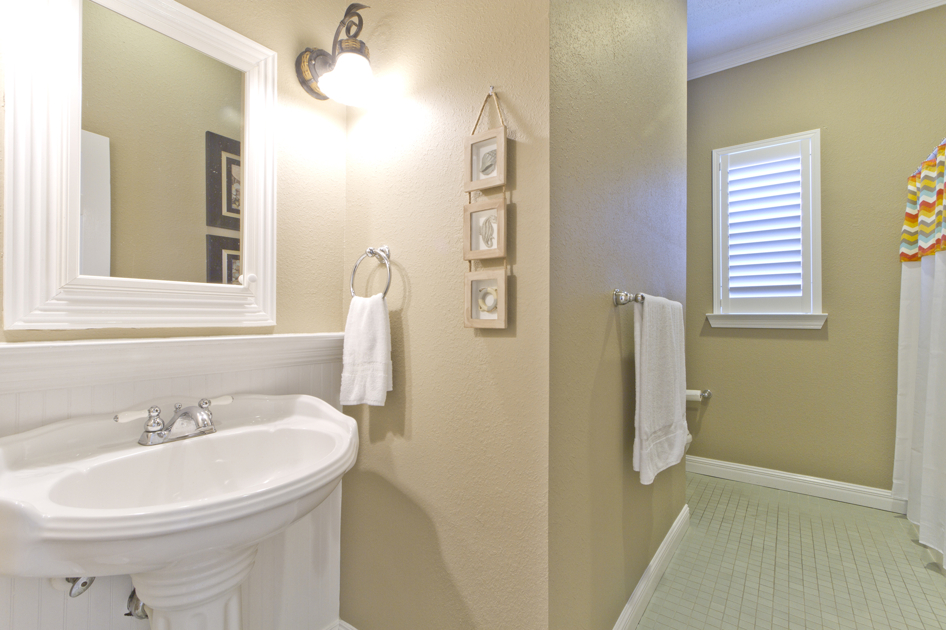 Upstairs guest bathroom with bathtub and shower