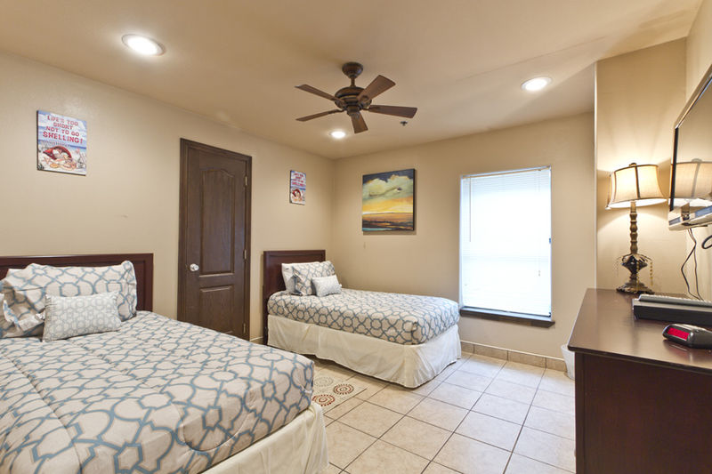 Condo # 1, guest bedroom with two Twin beds and a flat screen TV