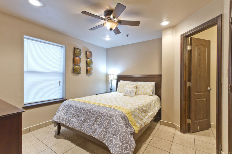 Condo # 2, master bedroom with Queen bed, flat screen TV and private on-suite bathroom