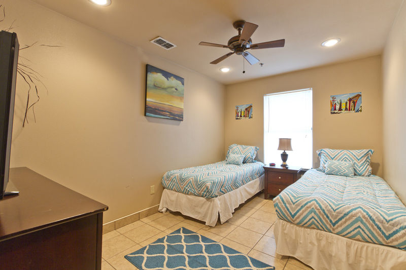 Condo # 3, first guest bedroom features two Twin beds and flat screen TV
