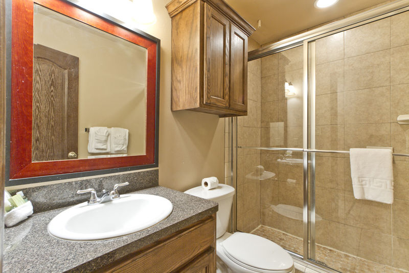Condo # 3, master bathroom with large vanity mirror and walk-in shower