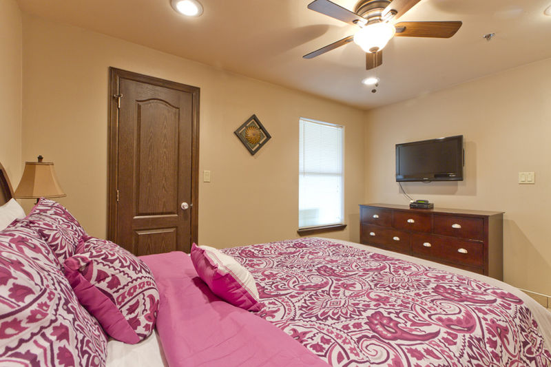 Condo # 3, master bedroom with a Queen size bed, flat screen TV and a private bathroom