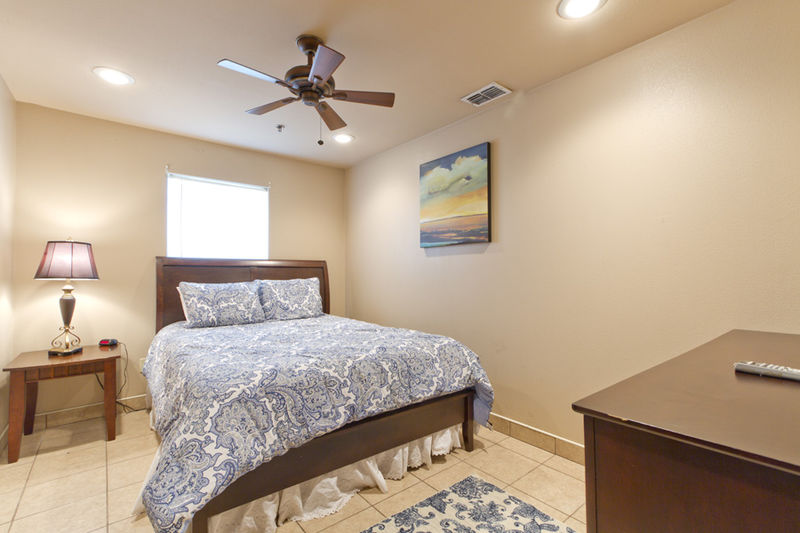 Condo # 4, first guest bedroom with Queen size bed also features a flat screen TV