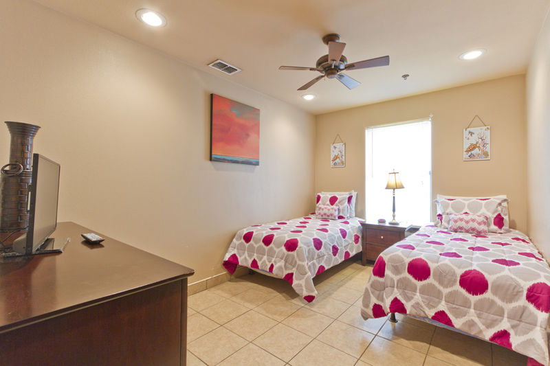 Condo # 4, second guest room with two Twin beds and a flat screen TV