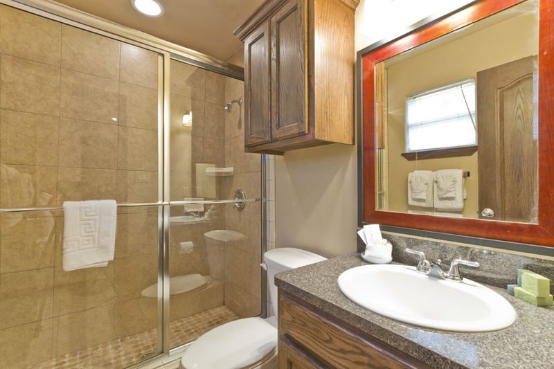 Condo # 4, master bathroom with walk-in shower and large vanity mirror