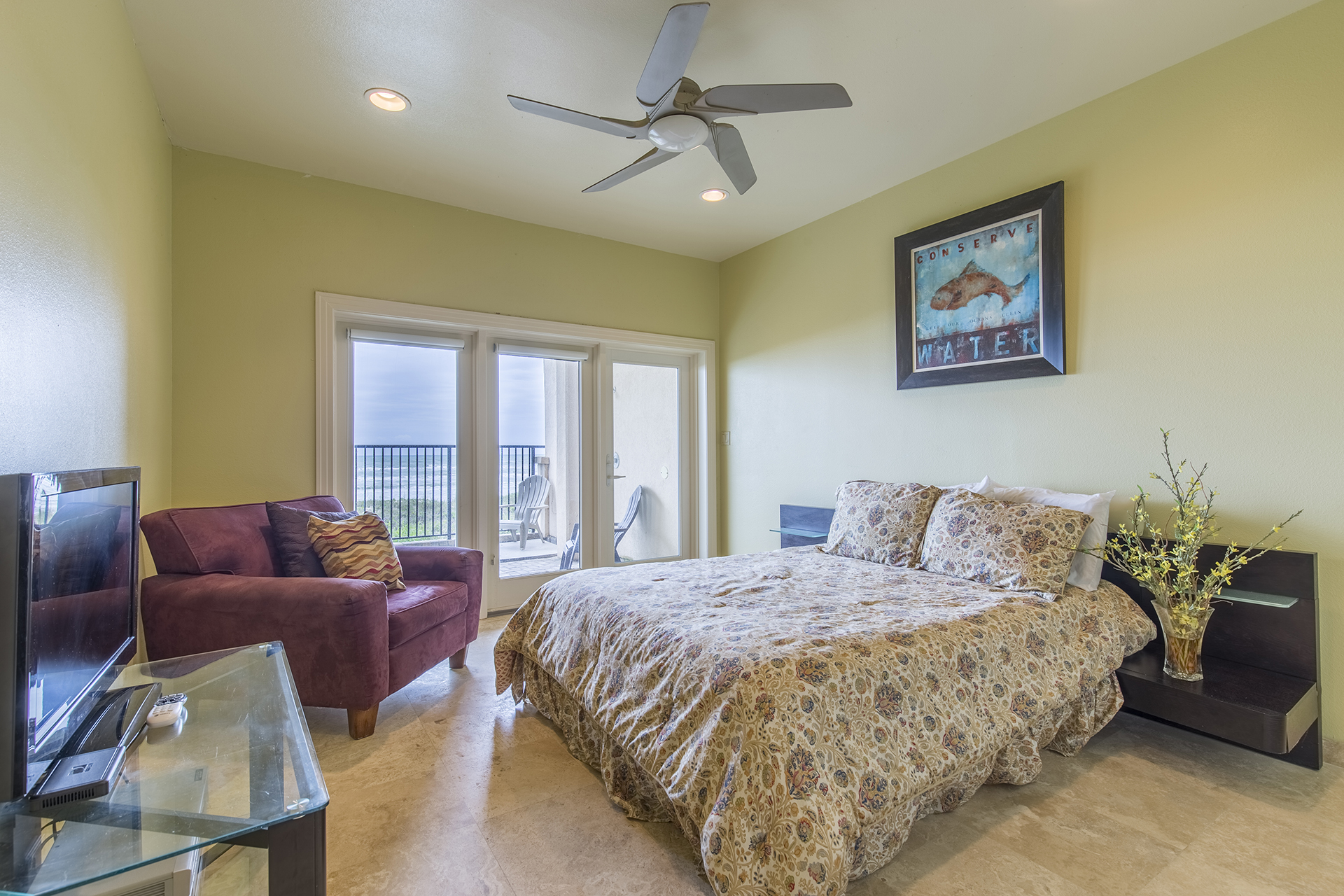 Ground floor guest room with access to the private pool & beach!