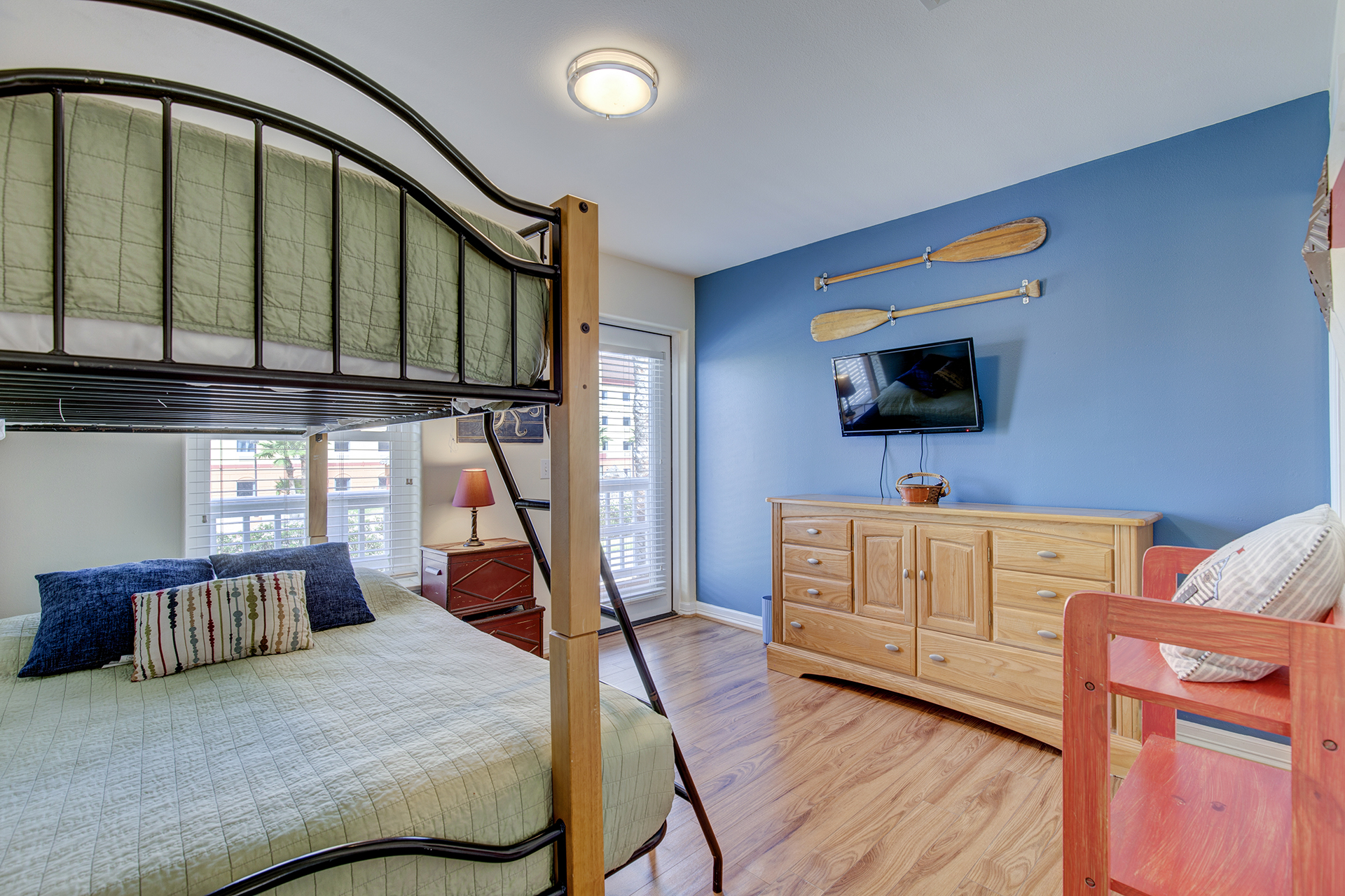 Guest bedroom with bunk beds and flat screen.