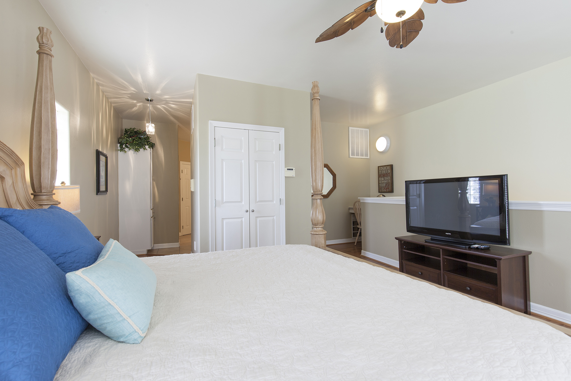 Master bedroom with flat screen t.v. and office nook.